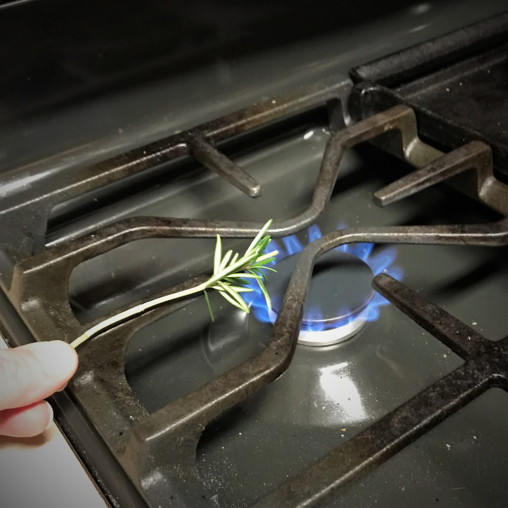 My kitchen torch was out of fuel, so I turned to my trusty gas range to scorch the rosemary.